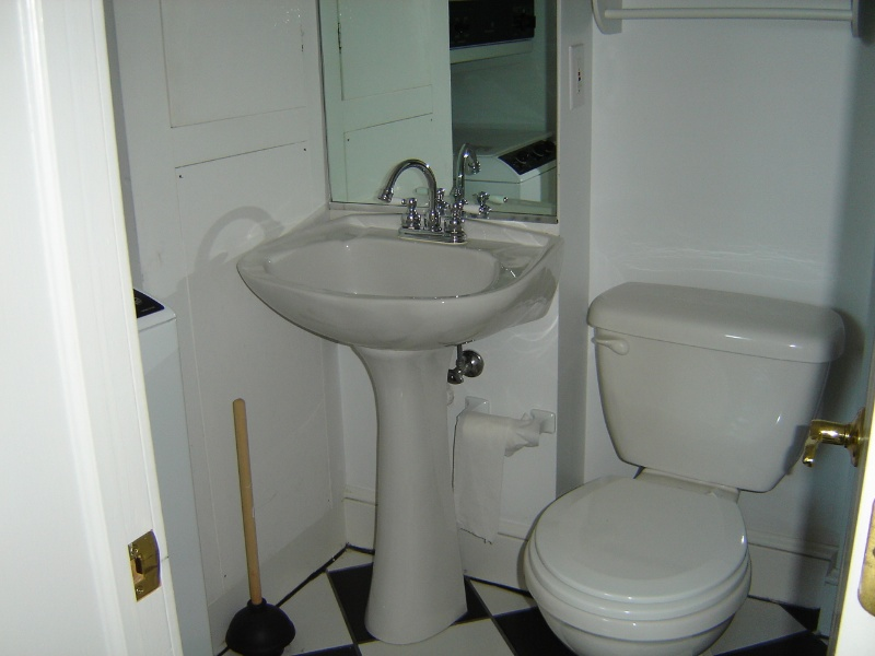 Bathroom With Designer Pedestal Sink, Ceramic Tile Checkerboard Floor And  Cast Iron Tub