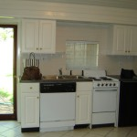 Kitchen with Ceramic Tile Flooring, Dishwasher, Range/Oven, Under-Counter Refrigerator and Freezer